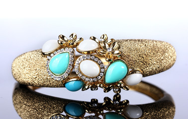 Beautiful golden bracelet with precious stones