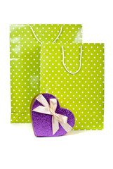 Green paper shopping bags and heart box isolated on white backgr