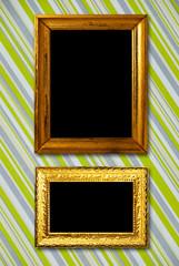 Gold frame on striped vintage wallpaper background