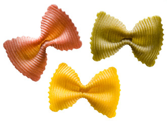 Multi colored pasta on a white background