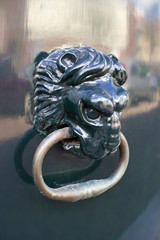 closeup of decorative traditional Dutch lion head door knob