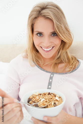 Close up, woman looking forward and smiling as she gets a spoon