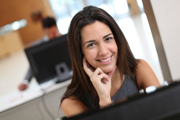 Smiling office worker at ther desk