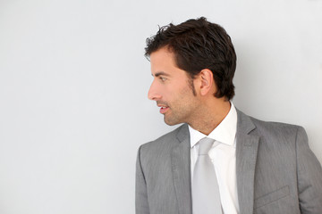Businessman standing on white wall