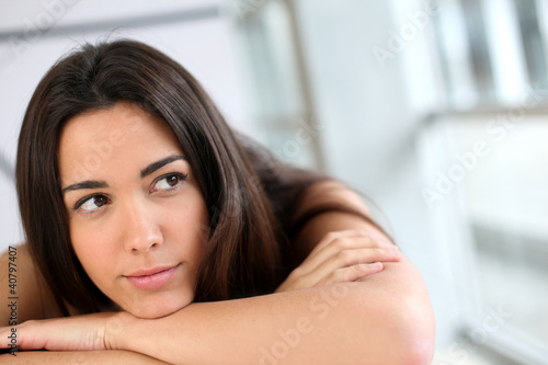 Portrait of brunette with bored look