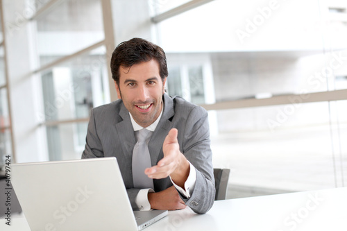 Portrait of businessman in meeting