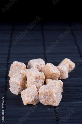 brown sugar on dark background