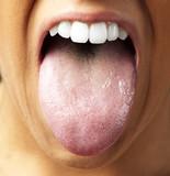 woman showing the tongue, closeup - 40798041