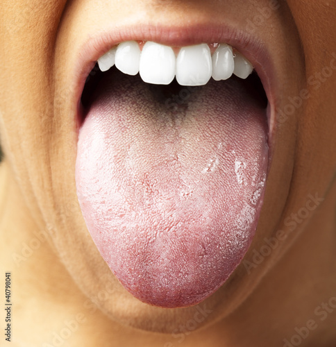 Poster woman showing the tongue, closeup
