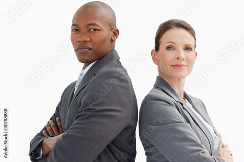 business people with hands crossed looking at camera