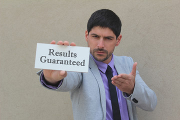 Results Guaranteed - written on a sign holded by a businessman