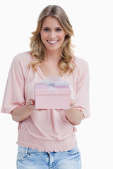 Smiling young woman holding a present