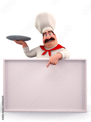 Happy chef pointing towards sign
