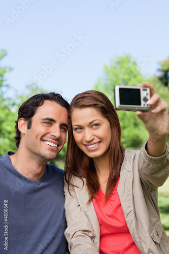 Woman and her friend looking towards her camera for a picture of