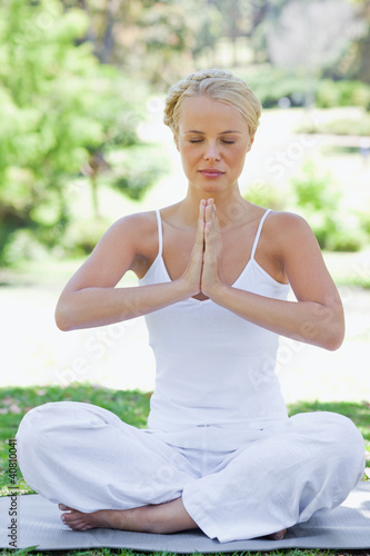 Relaxed woman in a yoga position