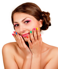 Beautiful sweet girl with multi-colored nails and makeup