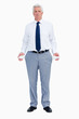 Portrait of a businessman with empty pockets