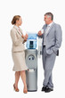Business people laughing next to the water dispenser