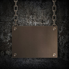 Grungy Metal Plate hanging on a chain