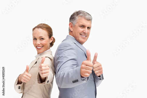 Portrait of business people approving back to back