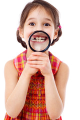 Girl showing teeth through a magnifier