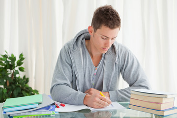 Male student doing his homework