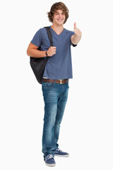 Smiling male student with a backpack the thumb-up