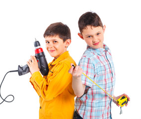 Two cute boys with tape and a drill.