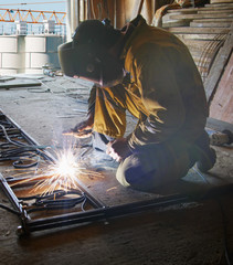 Welder with protective mask welding metal