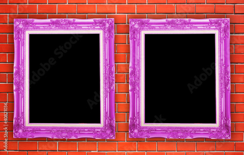 two purple frame picture with wall brick background