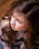 Teen girl looking away poster