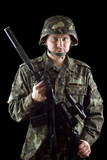 Armed soldier grasping m16 poster
