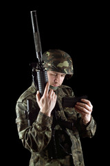 Soldier changing magazine of m16