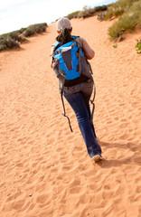 Woman walking the desert