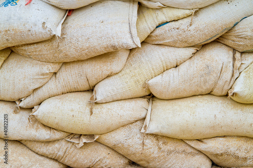 stack of old and dirty sand bags