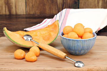 Cantaloupe melon balls in a bowl with selective focus on fruit i
