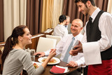 Fototapety Business lunch waiter taking order at restaurant