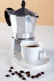 Moka pot and cup of espresso coffee