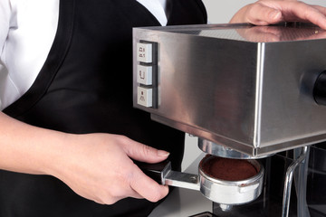 Barista using an espresso machine.