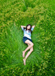 asian cute girl lying on meadow