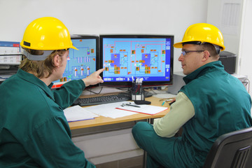 Industrial workers in control room