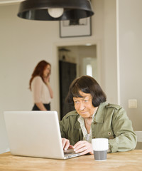 Senior woman with computer
