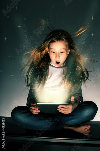 Surprised girl with tablets