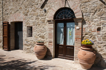 Two terracotta large jars to door side, farmhouse Umbria