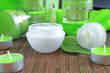creams for body care in transparent and green containers