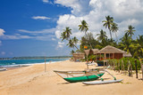 deserted tropical beach with boat, Sri lanka