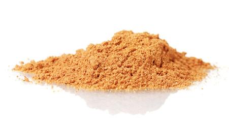 Cinnamon powder isolated on white