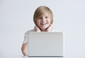 Happy boy with laptop