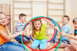 Children holding hula hoops