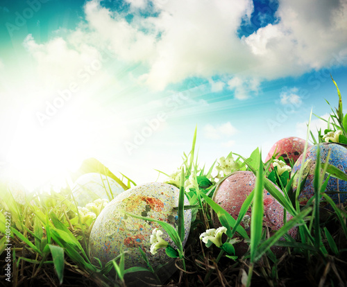 Colorful Easter eggs decorated with flowers in blue sky